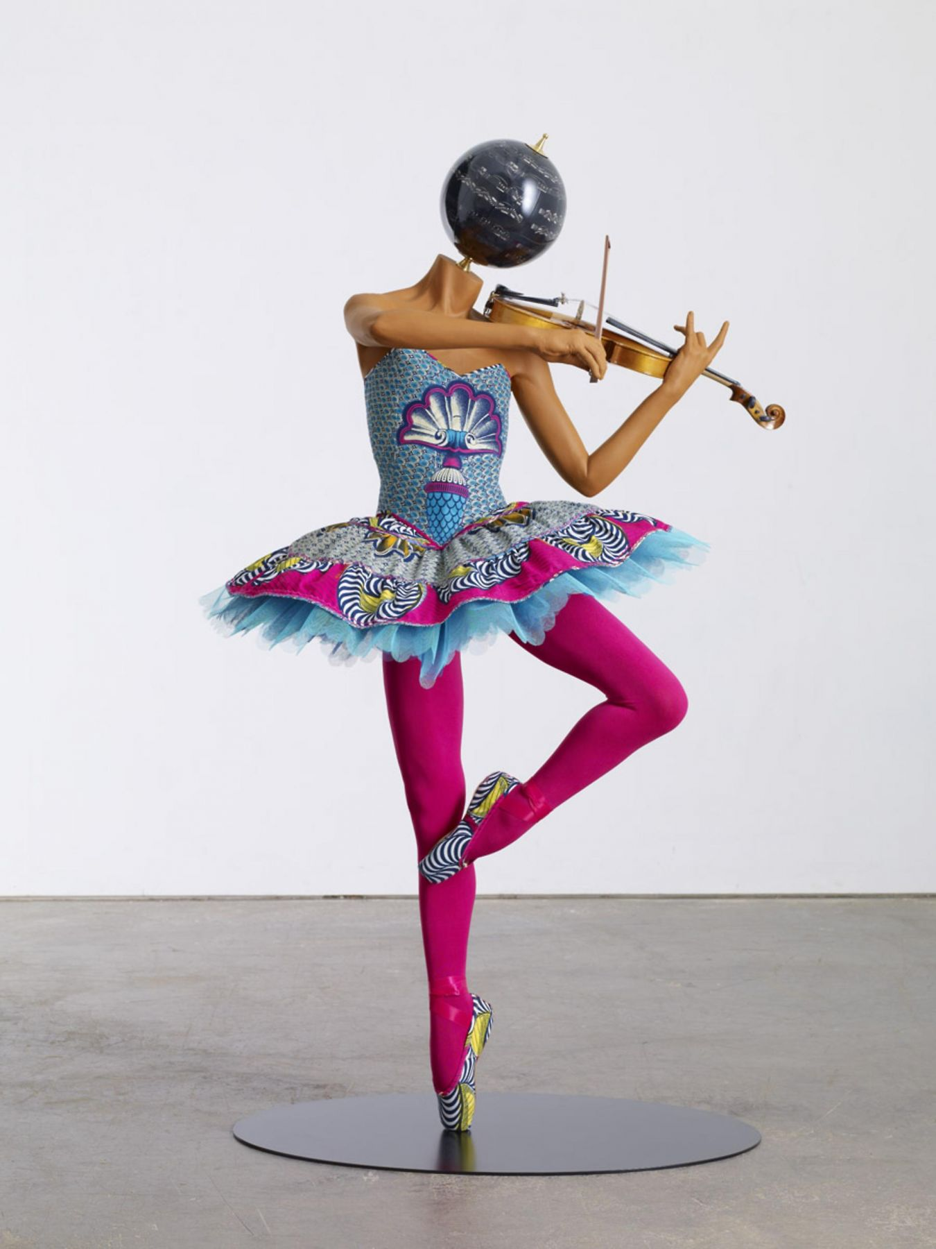 , YINKA SHONIBARE MBE, Ballerina With Violin (Giselle), 2013, Mannequin, Dutch wax African cotton textile, fibreglass, globe head, violin, pointe shoes, 55 x 37 x 29 3/16 in (140 x 94 x 75 cm)