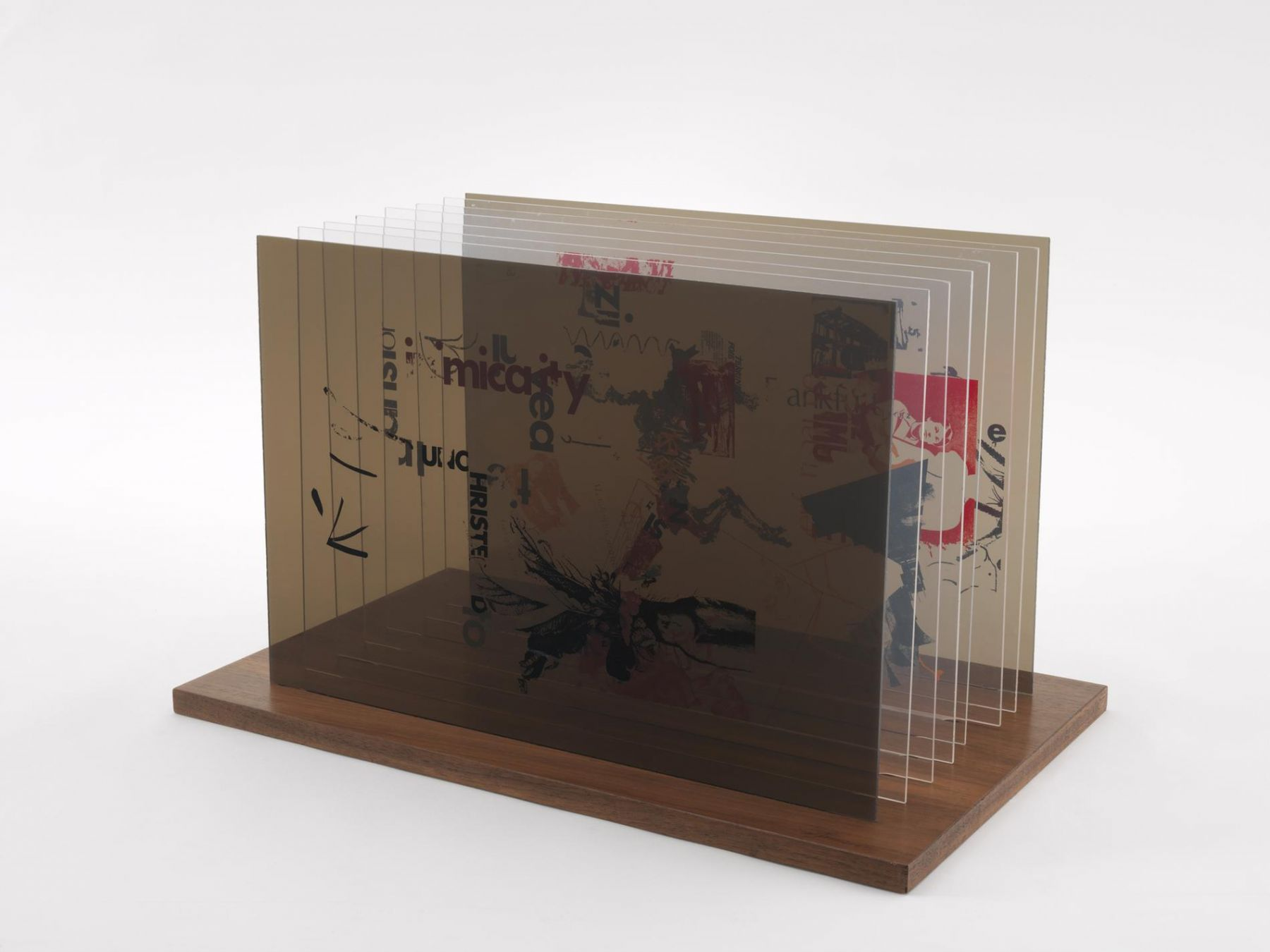 , JOHN CAGENot Wanting to Say Anything About Marcel Plexigram VI,1969Screenprint on eight Plexiglas panels with walnut base14 x 20 x 1/8 in. (35.6 x 50.8 x 0.3 cm)
