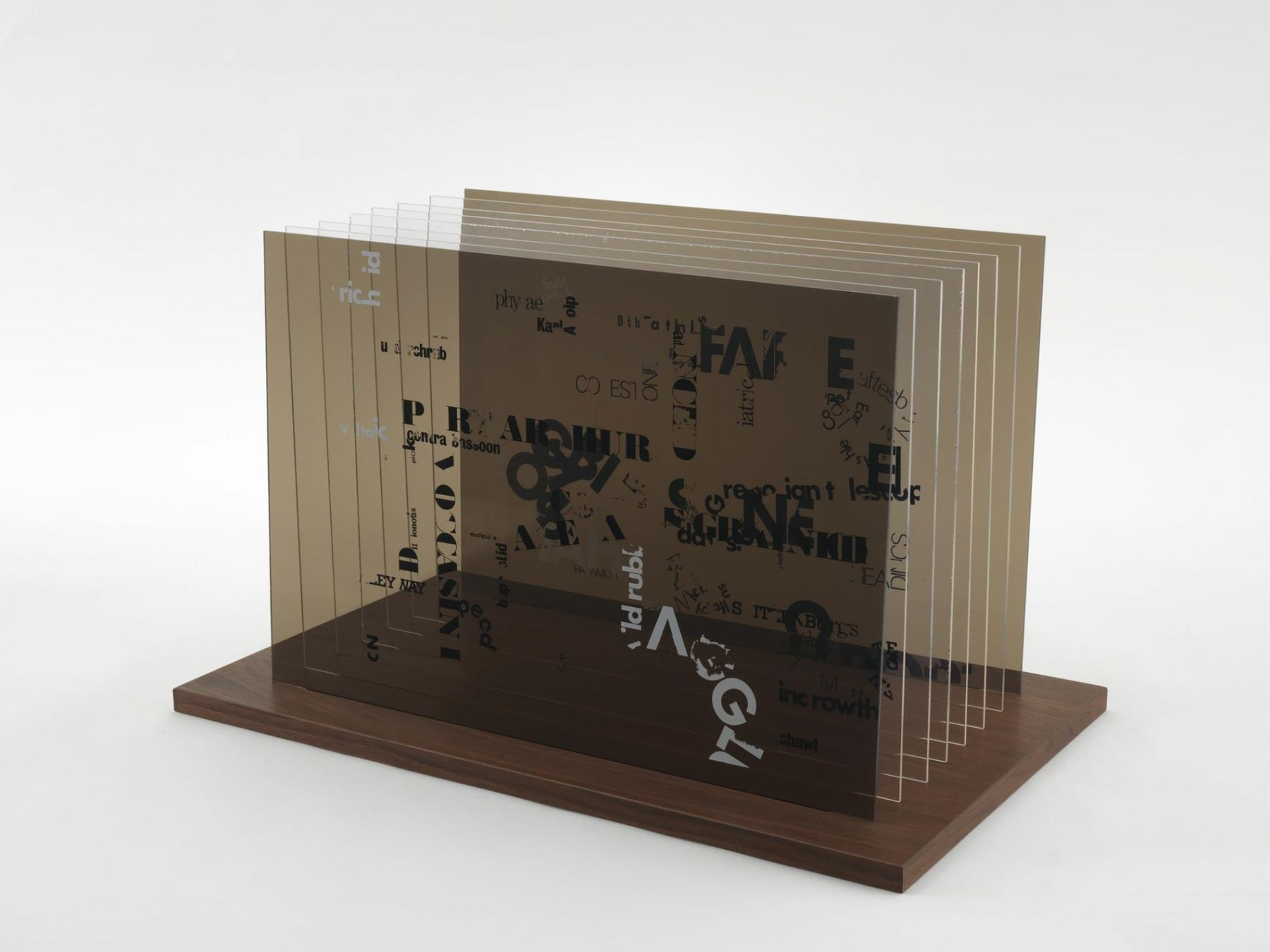 , JOHN CAGE Not Wanting to Say Anything About Marcel Plexigram I, 1969 Screenprint on eight Plexiglas panels with walnut base 14 x 20 x 1/8 in. (35.6 x 50.8 x 0.3 cm)