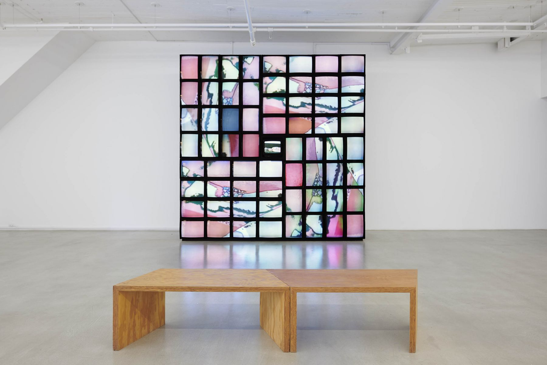 An installation comprised of many televisions