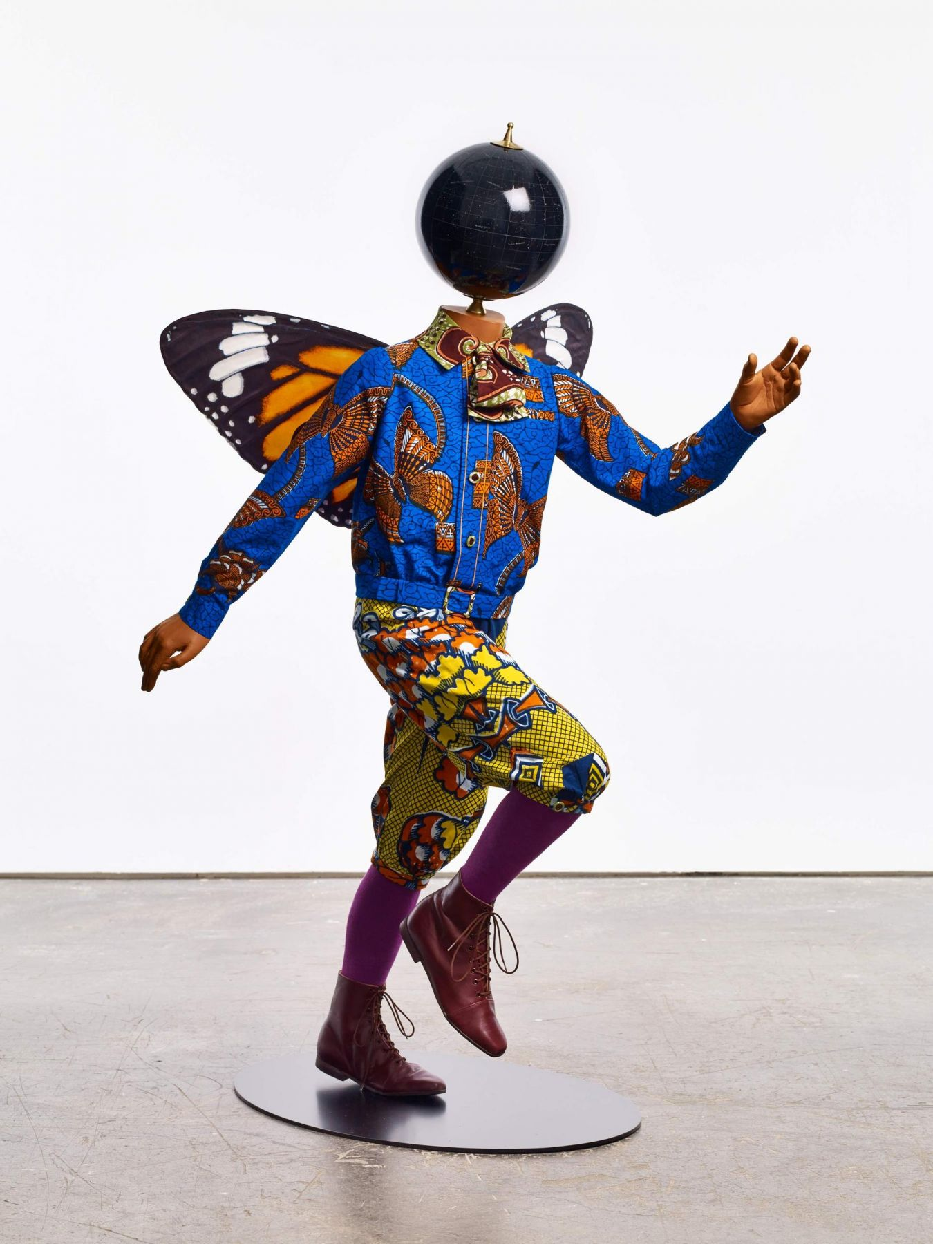 , YINKA SHONIBARE, MBE Butterfly Kid (boy), 2015 Fiberglass mannequin, Dutch wax printed cotton textile, silk, metal, globe, leather and steel baseplate 50 x 29 1/2 x 34 5/8 in. (127 x 75 x 88 cm)