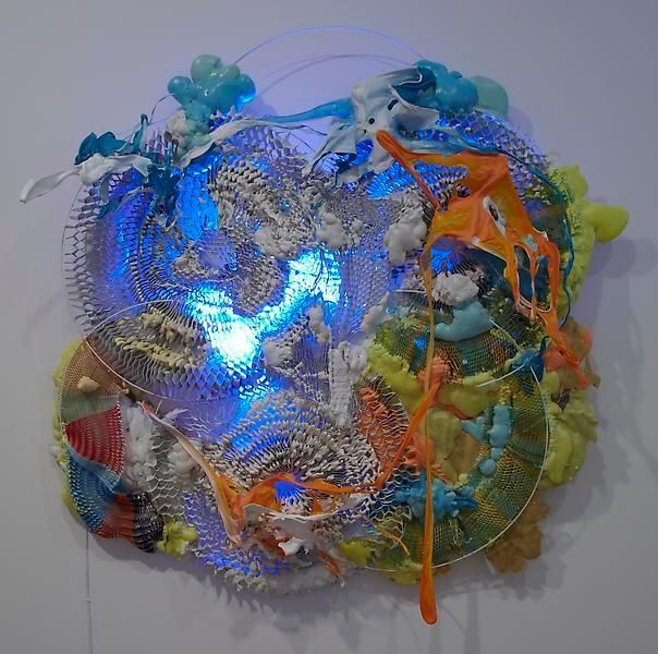 Humming in 5 Parts, 2012, Honeycomb cardboard, melted plastics, expanded foam, mild steel rod, fluorescent light, 61 x 61 x 12 inches, MMG#20617