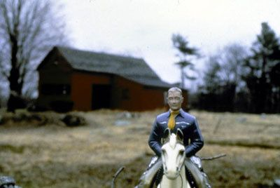 Laurie Simmons, Man/Blue Shirt/Red Barn, 1979