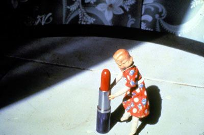 Laurie Simmons, Pushing Lipstick (Red Lipstick), 1979