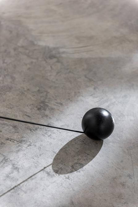 Magdalena Fernández, 2i000.017 (detail), 2017. Iron spheres with black elastic cord, variable dimensions