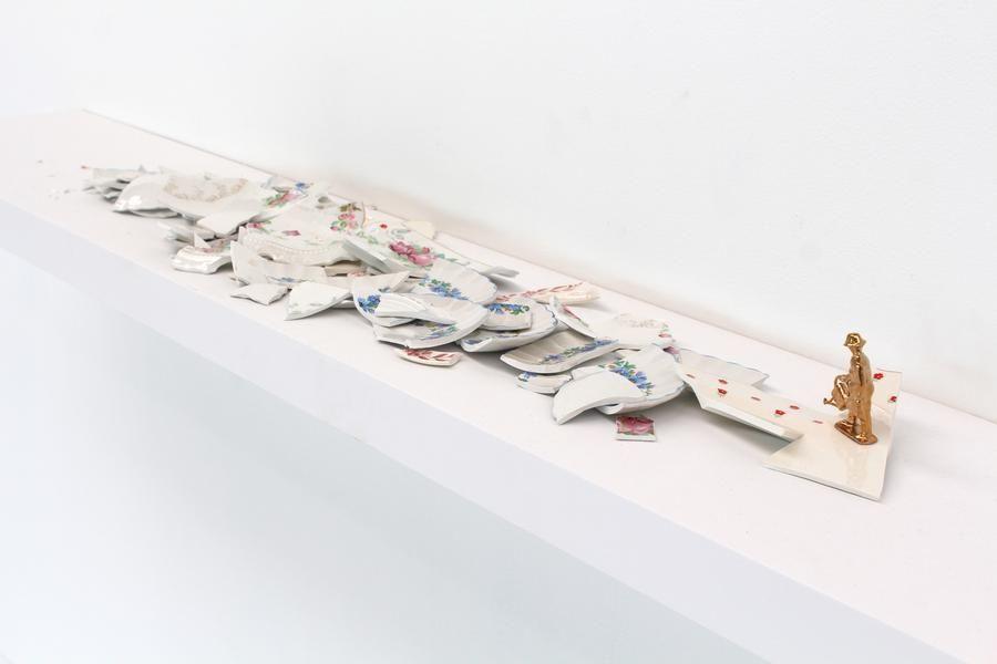 Liliana Porter. The Gardener,2016.Ceramic fragments and figurine on painted shelf,75 x14 x 6 in.