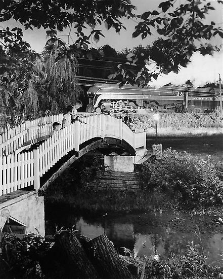 The Keith children fishing as train no. 2 passes. Lithia, Virginia 1955