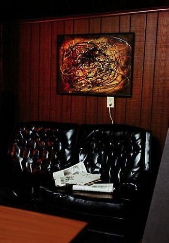 William Eggleston. UNTITLED (BLACK SOFA). 1974.