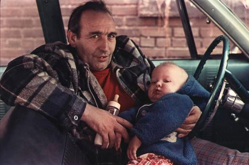 Man by Red Shirt in Car with Baby, Wilkes-Barre, PA, 1977, 14 x 17 inch dye transfer print