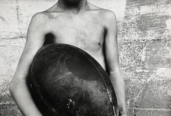 Boy and Football, 1974, 	16 x 20 inch gelatin silver print