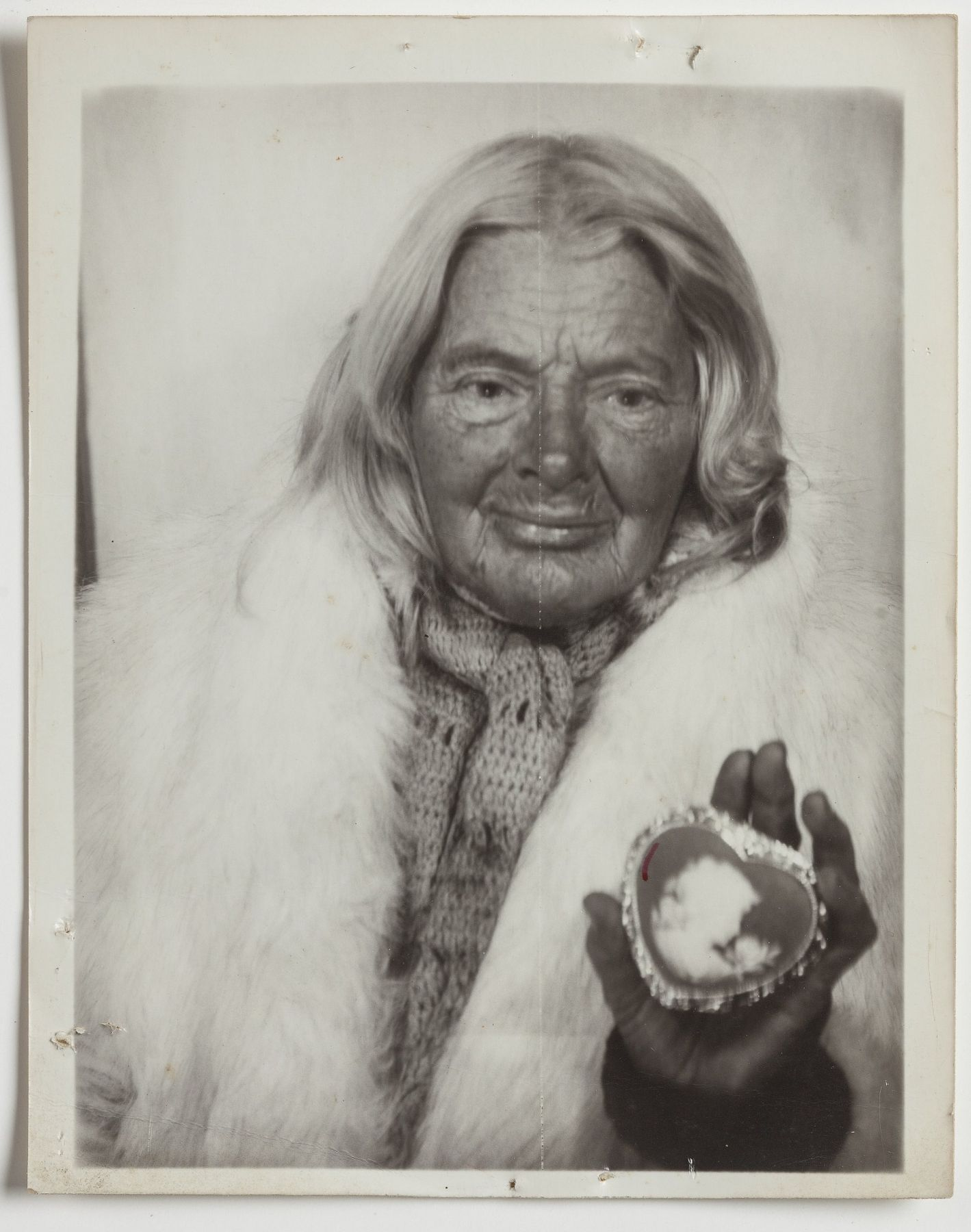 Lee Godie Untitled (in white fur stole with heart-shaped cameo), n.d.
