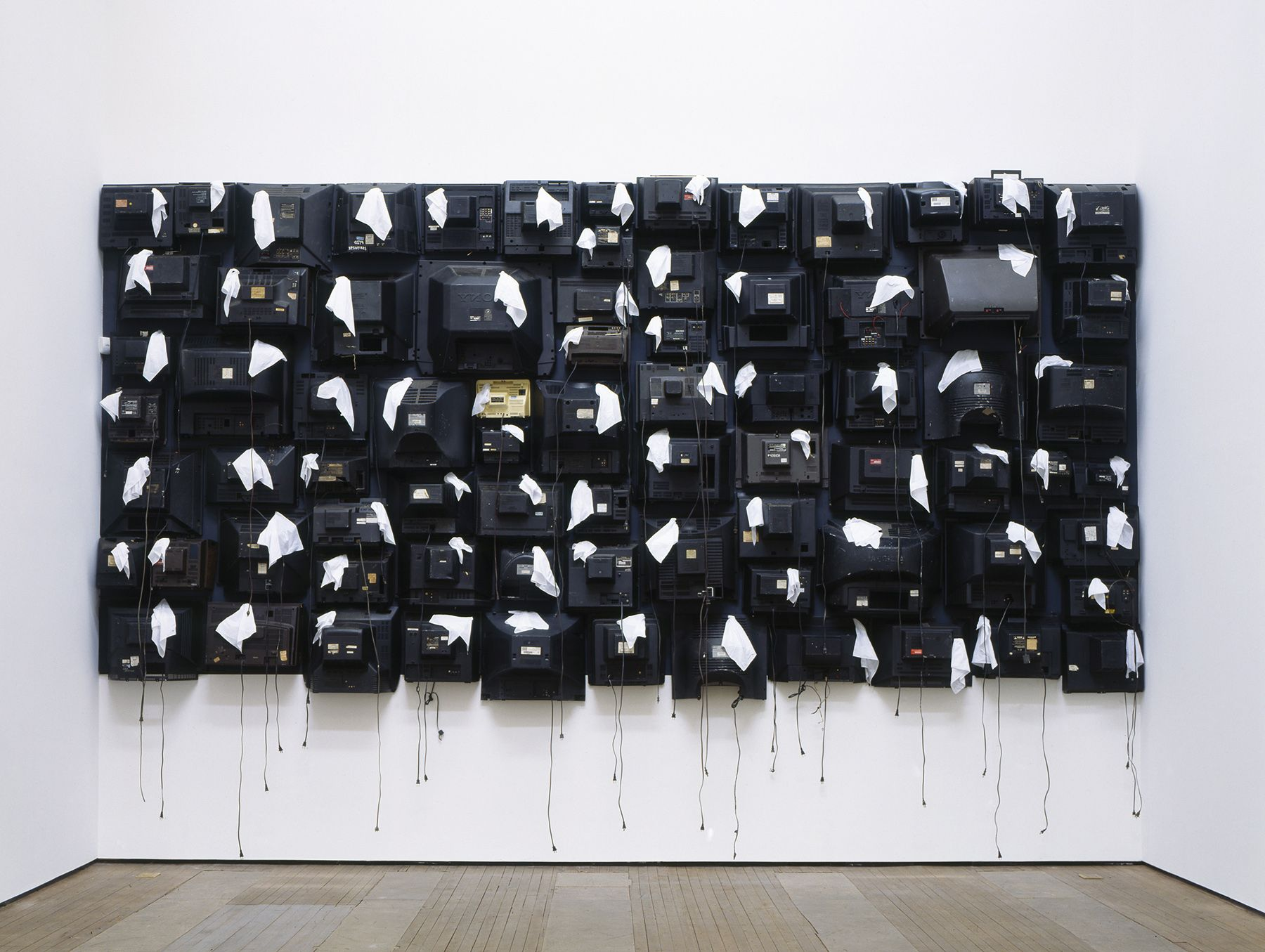 Airplane Tears,2005 Site-specific installation of found TV backs and facial tissues