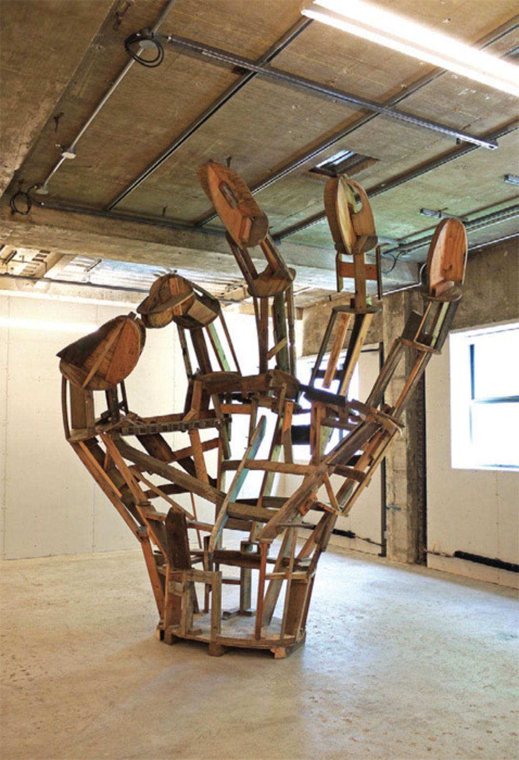 """Peter Coffin,Untitled (Unfinished OK Hand), 2012, wood, wire mesh, bolts, screws, 12' 7 1/2"""" x 6' 5"""" x 11' 6""""."""