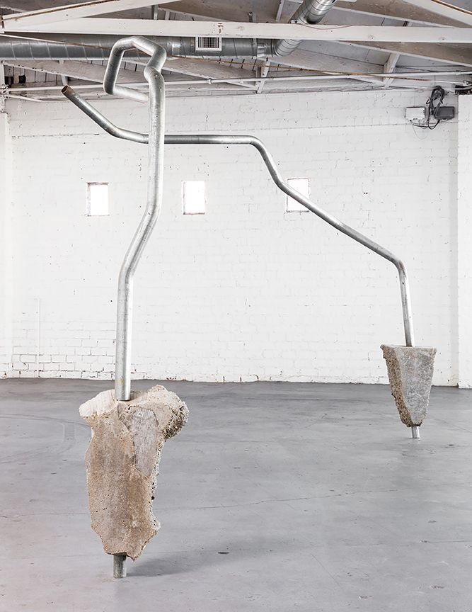 "The physical threshold of ""Concrete Island"" is Ruben Ochoa's Pinky Swear—two arcs of metal frozen overhead in a twisting dance. These galvanized steel posts have their ""feet"" mired in blocks of poured concrete—the meta-material of this city. Concrete is to L.A. what marble is to Rome."