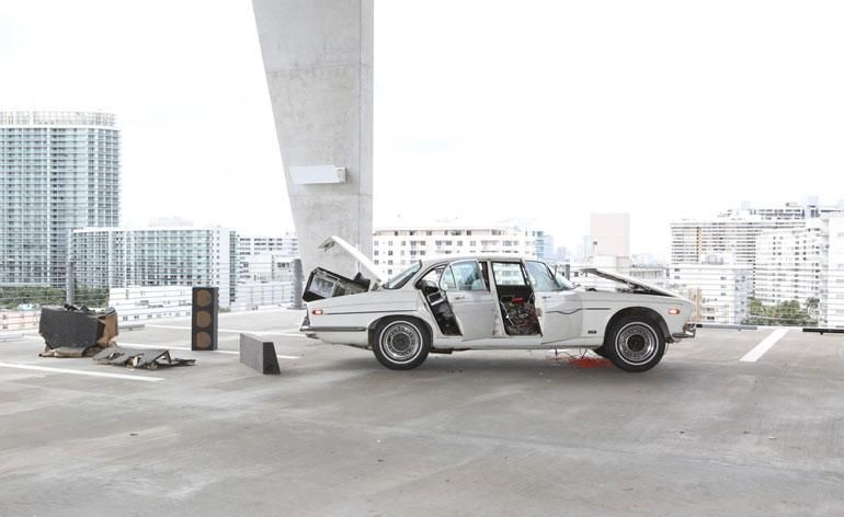 'Welfare Mothers Make Better Lovers', by Dan Colen and Nate Lowman, 2008, comprises a refashioned 1973 Jaguar. The car park itself was designed by architects Herzog & de Meuron