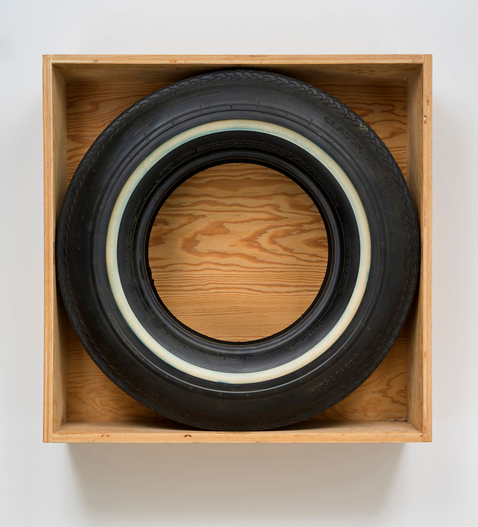 "John Dogg's 1986 ""Untitled (Classic Belted),"" a round tire circumscribed by a square box. via Venus Over Manhattan"