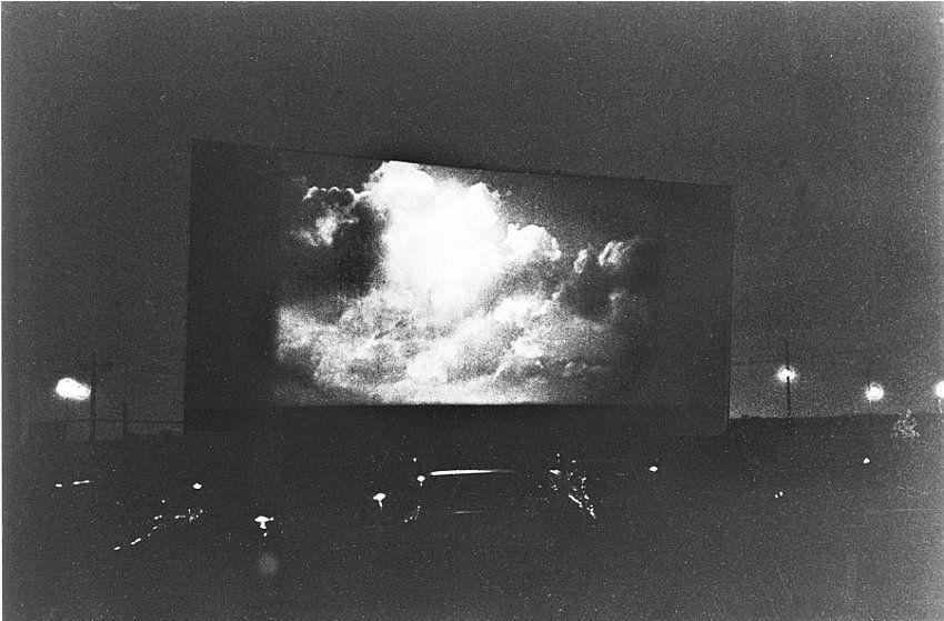 Diane Arbus, Clouds on screen at a drive-in, N.J.