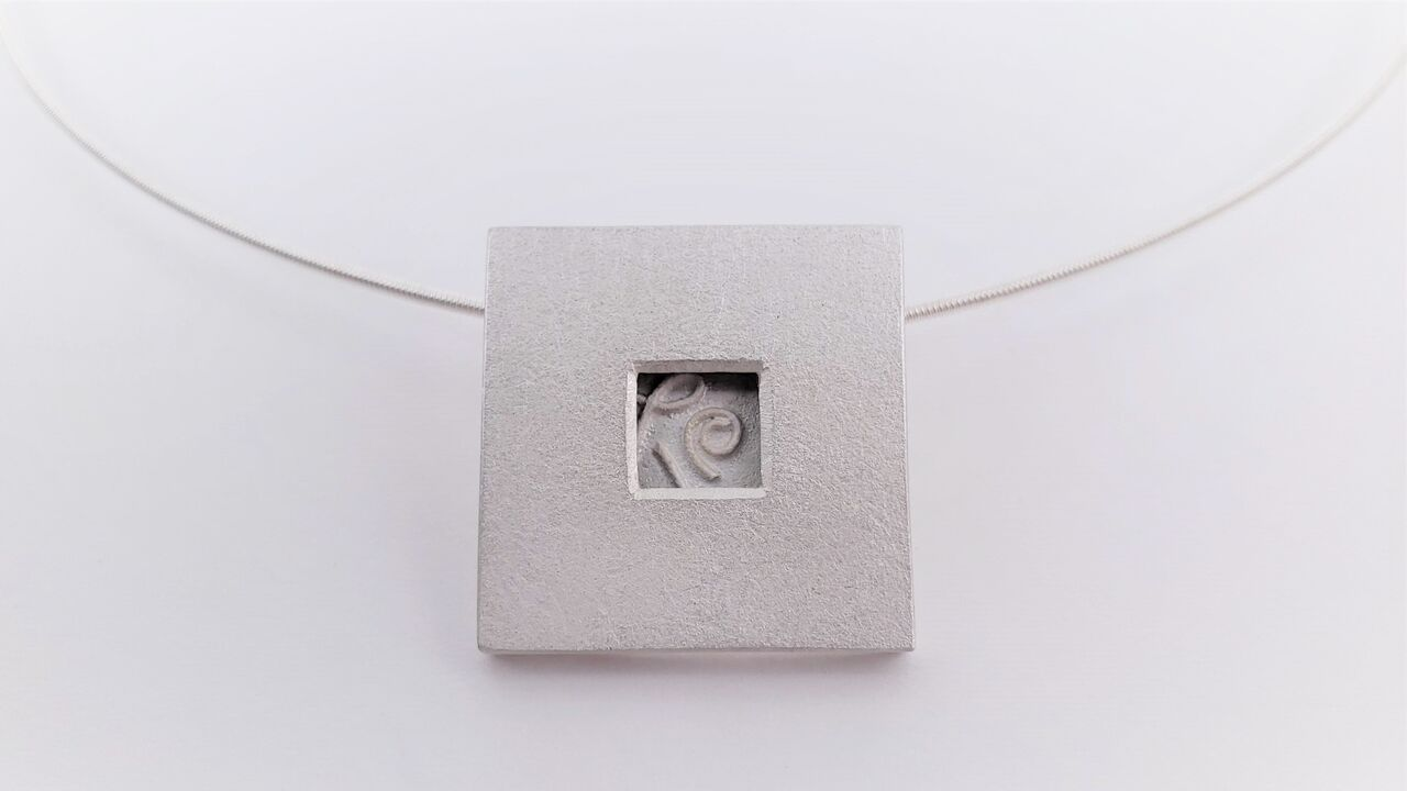 Ann Parkin, Pendant on neck wire - Particle Box #1