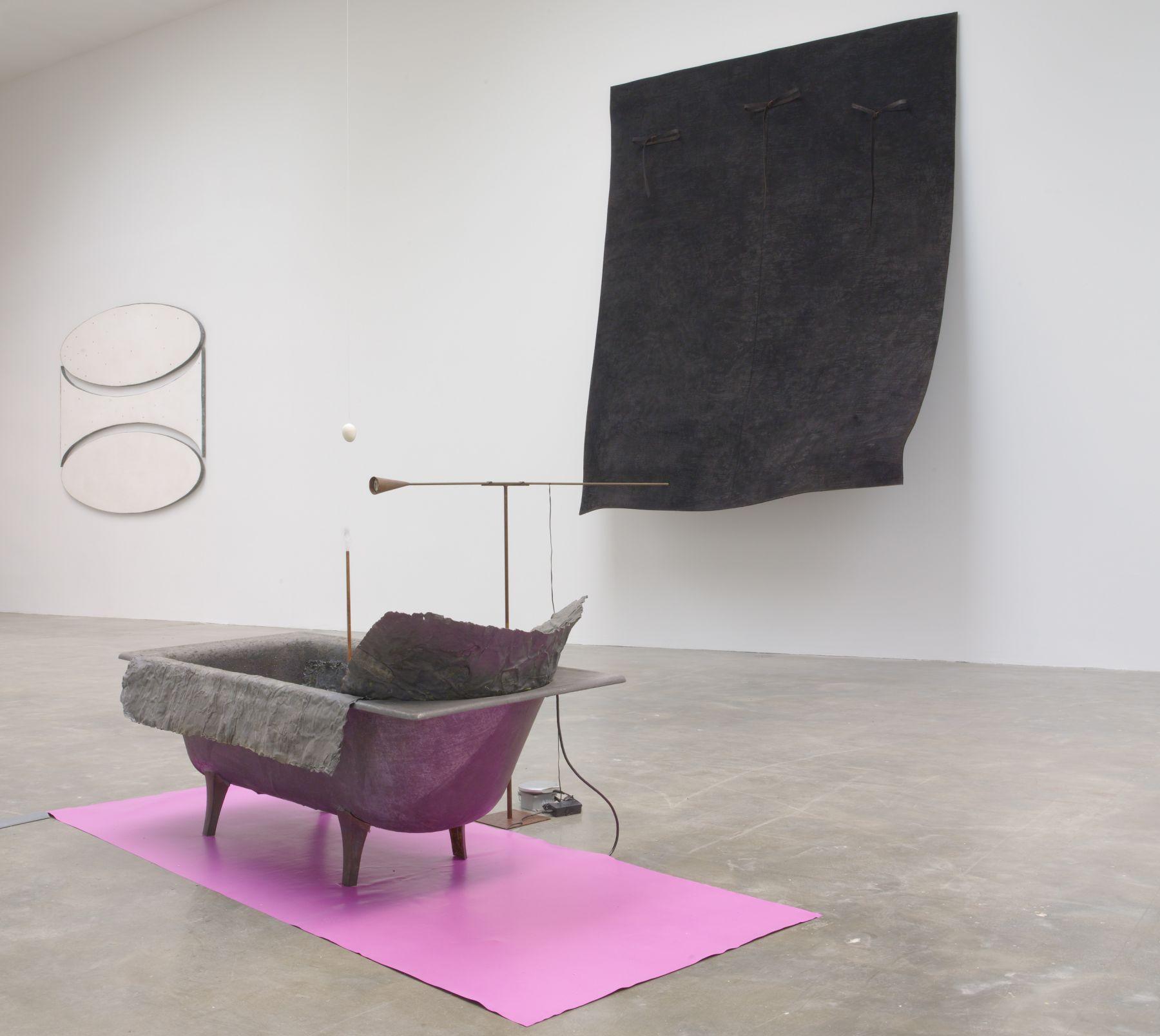 an installation view of a Pier Paolo Calzolari exhibition in a New York City contemporary art gallery