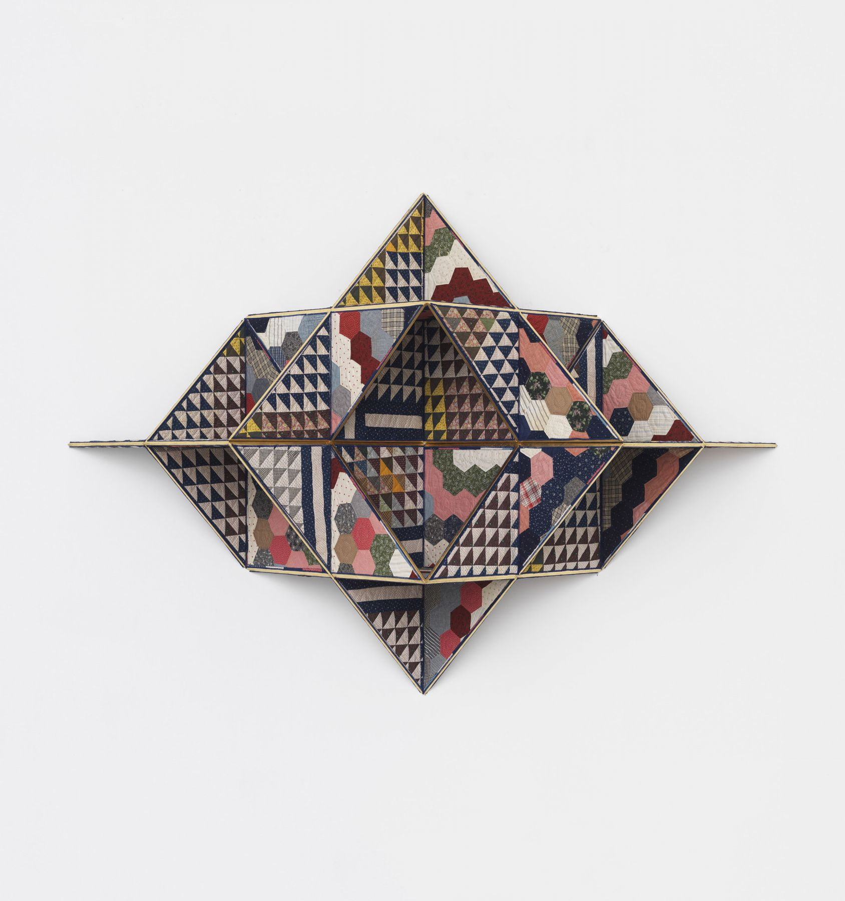 a geometric sculpture made of quilts by the artist Sanford Biggers