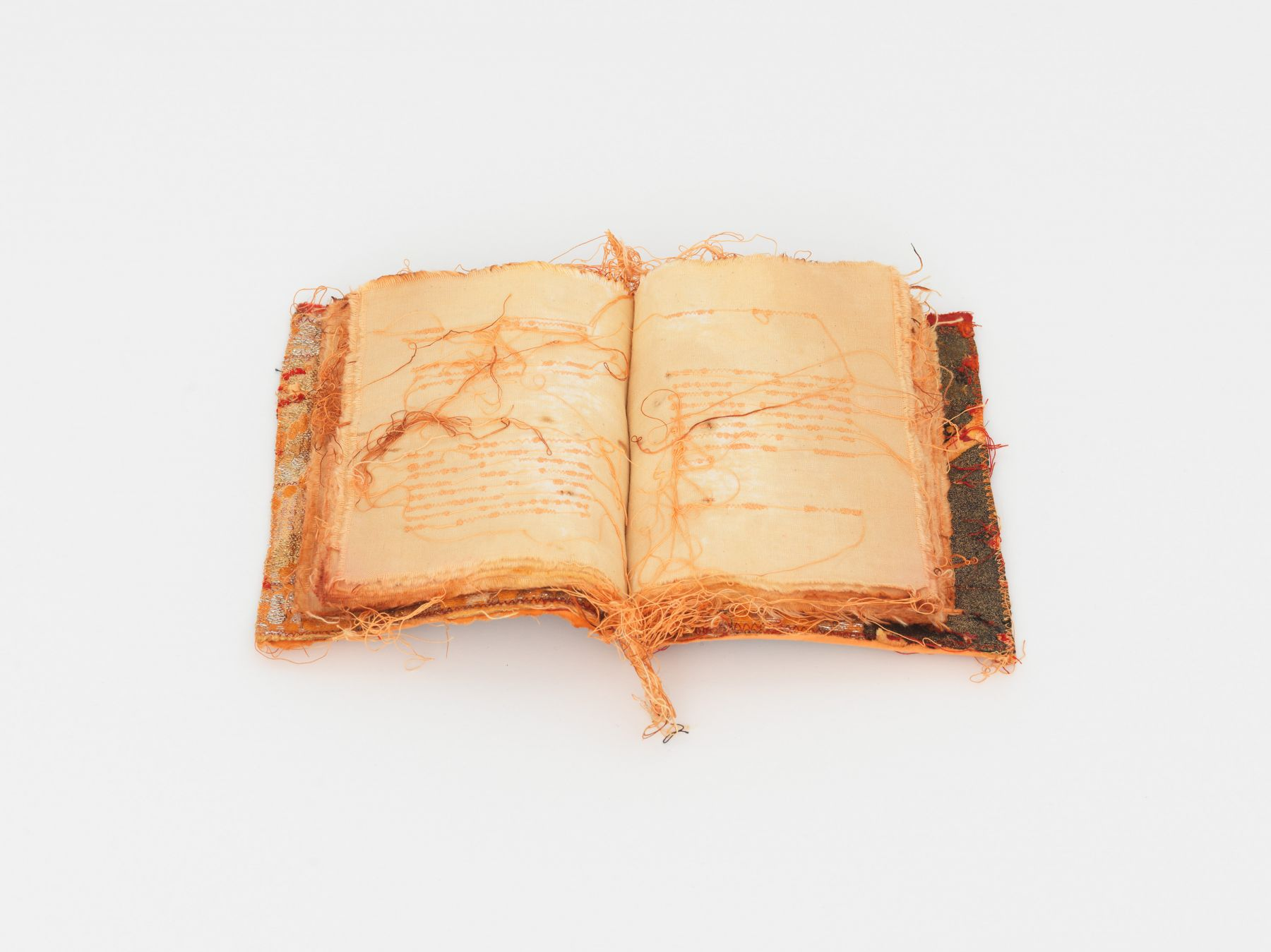 an embroidered book by italian female artist maria lai