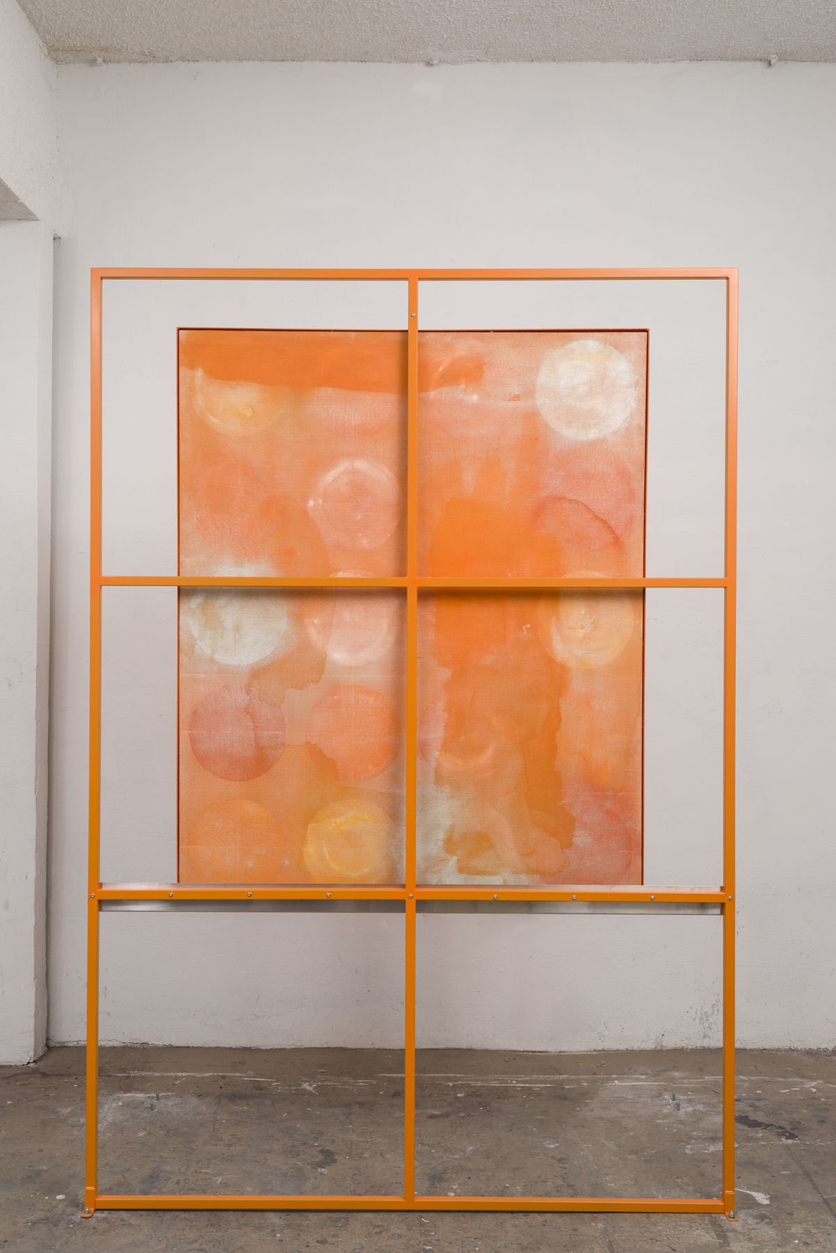 an orange grid artwork that is two-sided by contemporary artist dashiell manley