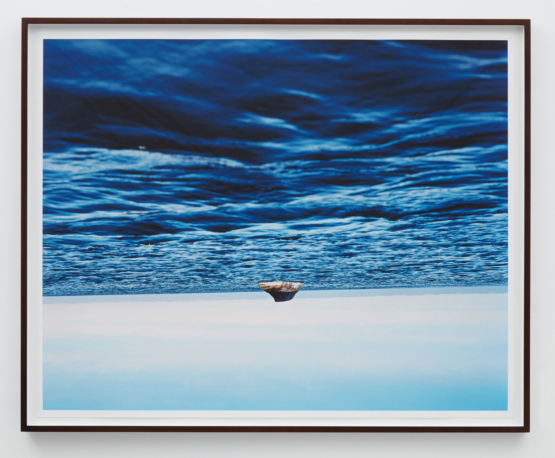 a photograph of a boat on water by thiago rocha pitta who is interested in art about the environment