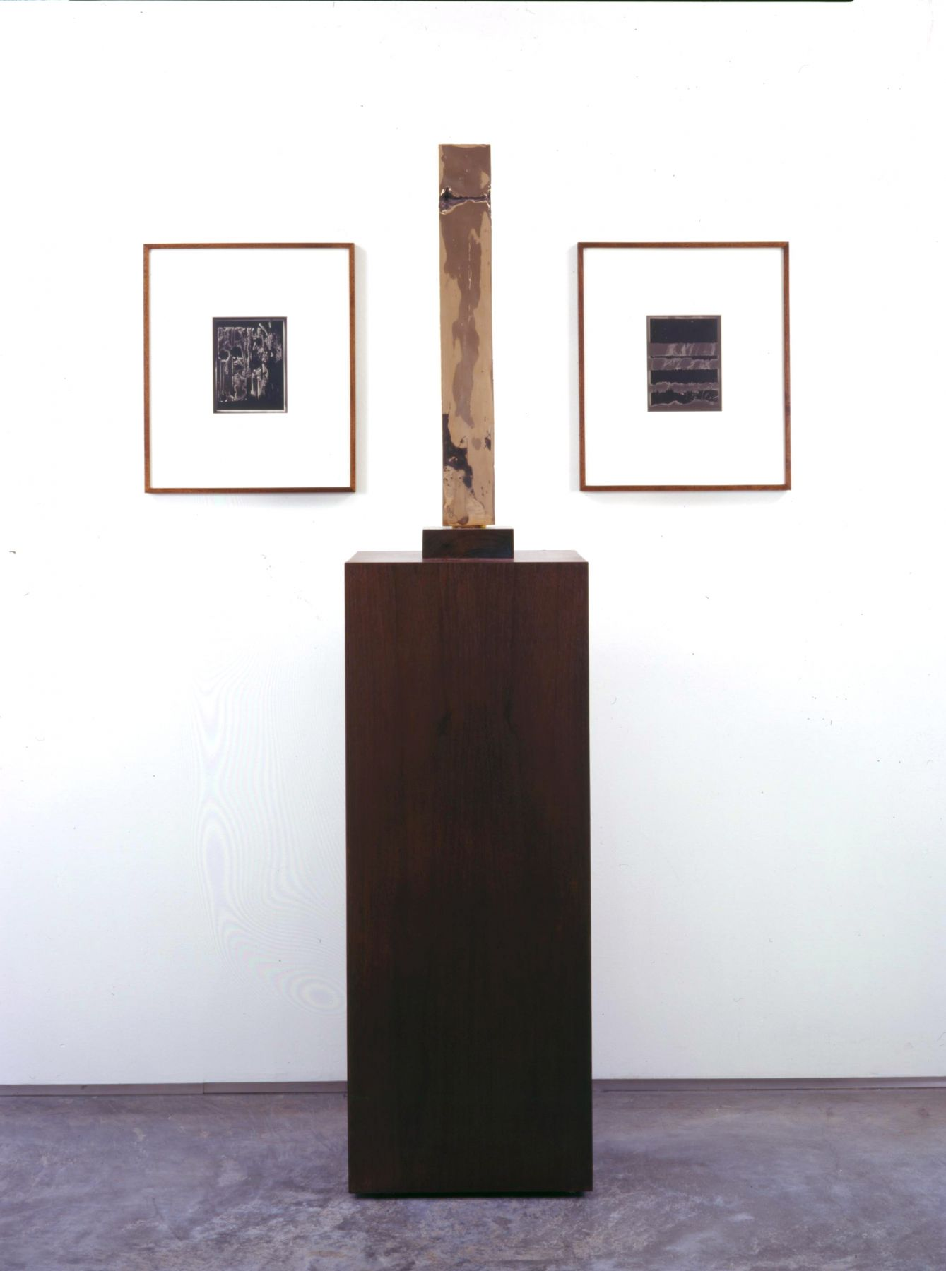 installation by anthony pearson with rectangular sculpture flanked by two photographs