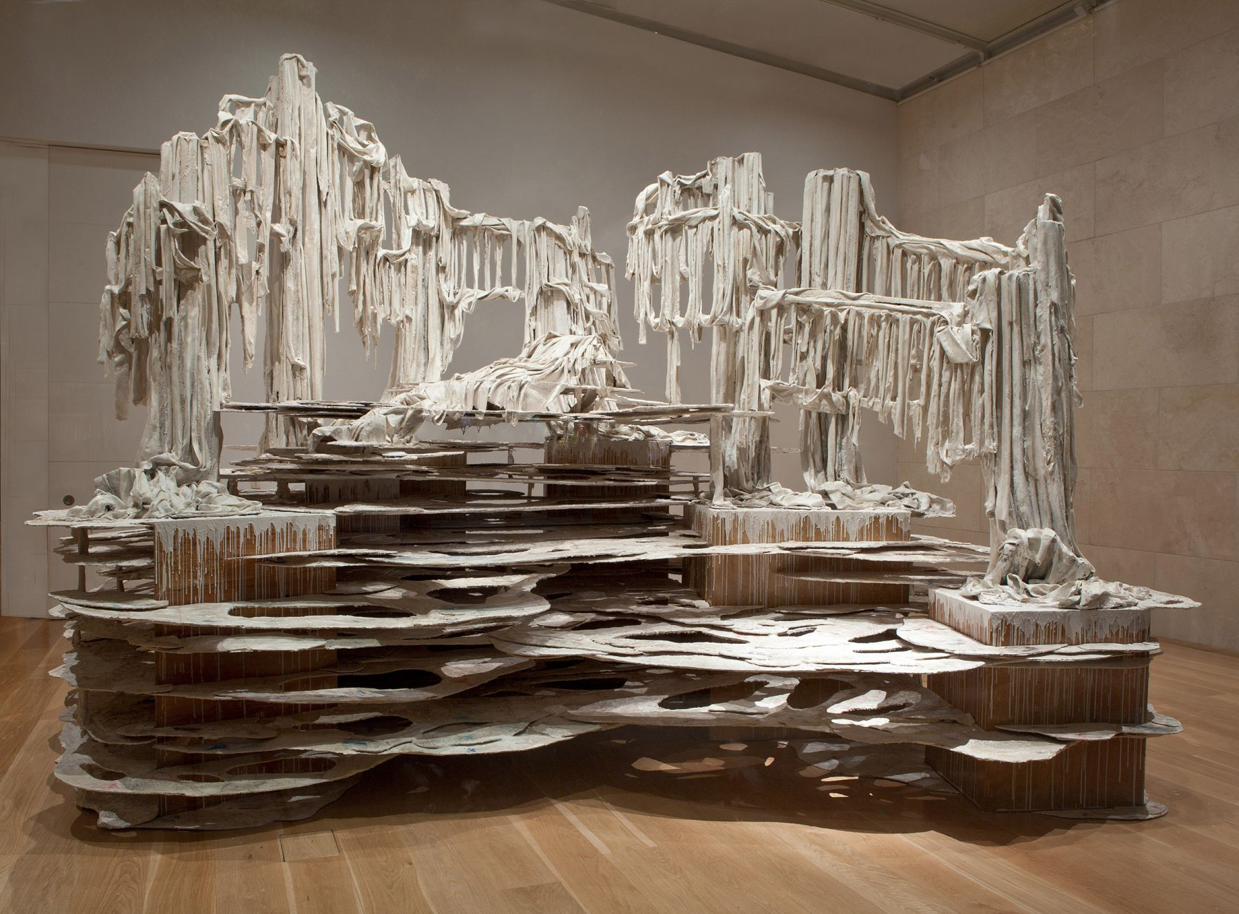 a large installation sculpture of dripping forms by Diana Al-Hadid