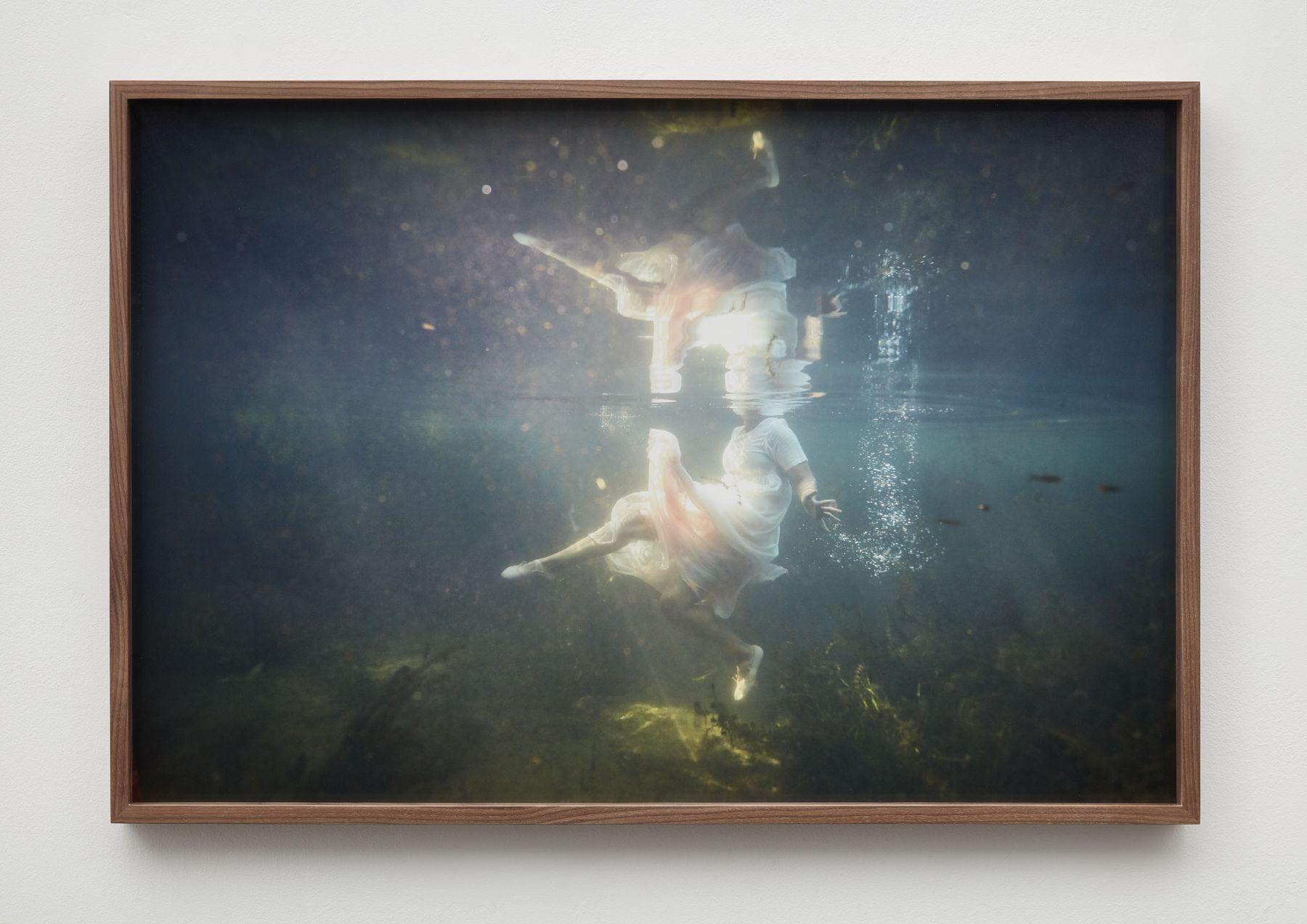 Photograph of figure in white dress underwater by Allison Janae Hamilton