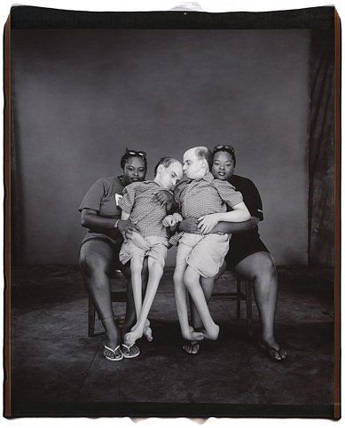 Bruce and Brian Kuzak, with their nurses, Teresa and Tillie Merriweather, 2001, 	Unique polaroid