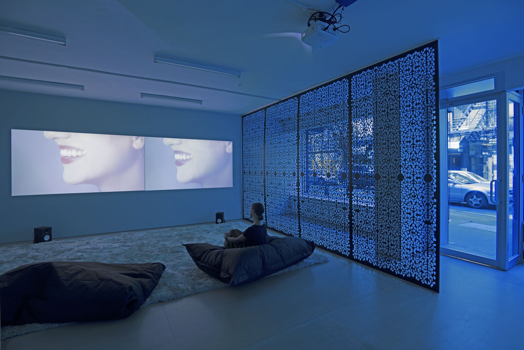 a two channel film installation by sue de beer in a contemporary art gallery