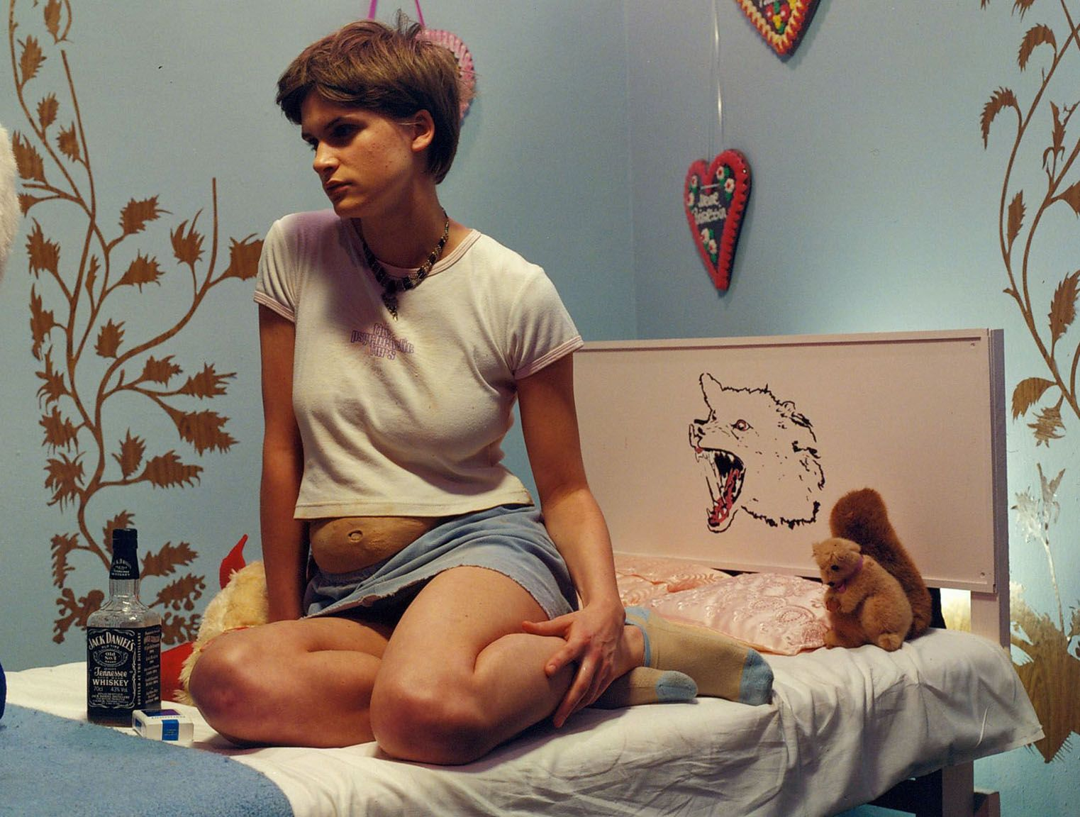 a photograph by sue de beer of a pregnant girl in a bedroom
