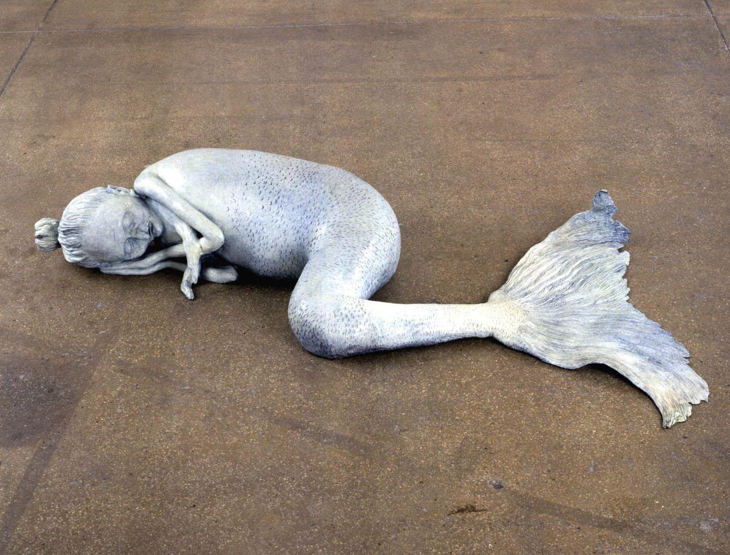 sculpture of a sleeping mermaid by liz craft