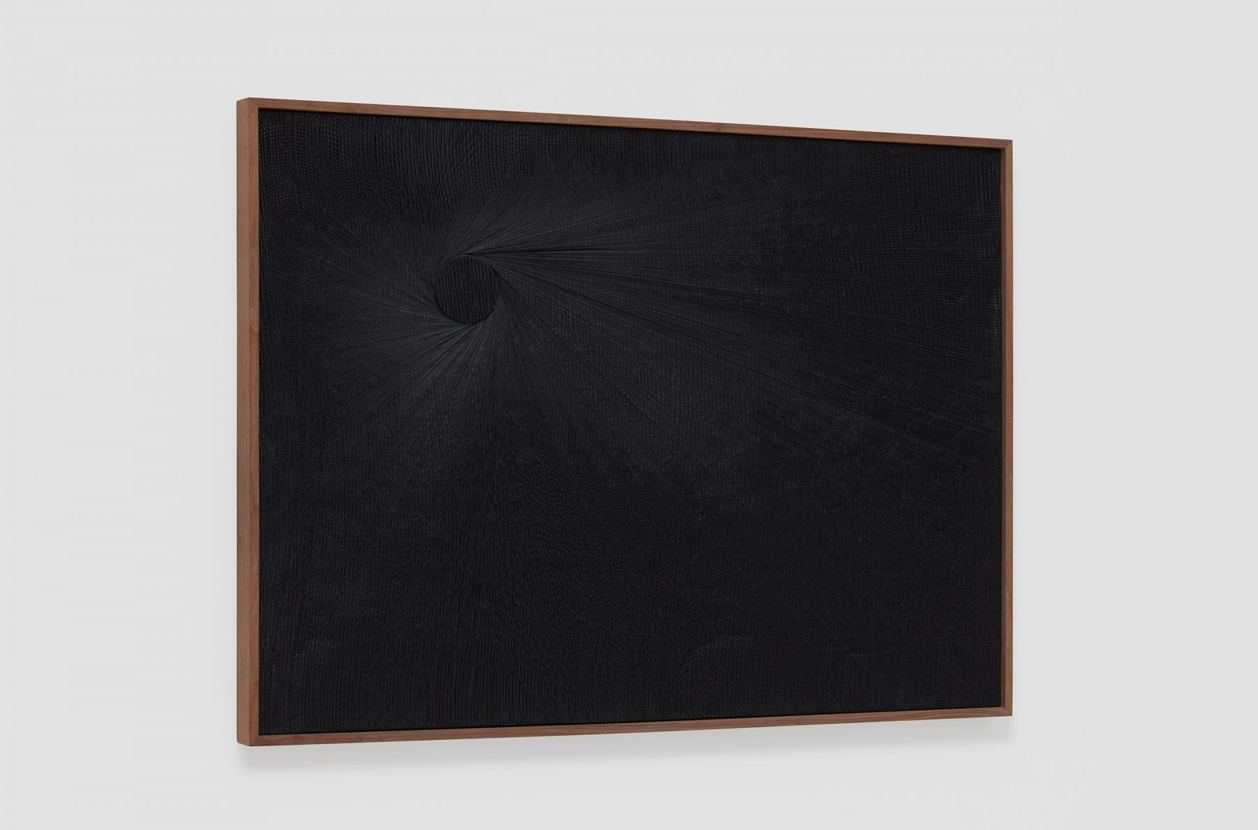 a dark black painting at an angle to see the cut plaster work by anthony pearson