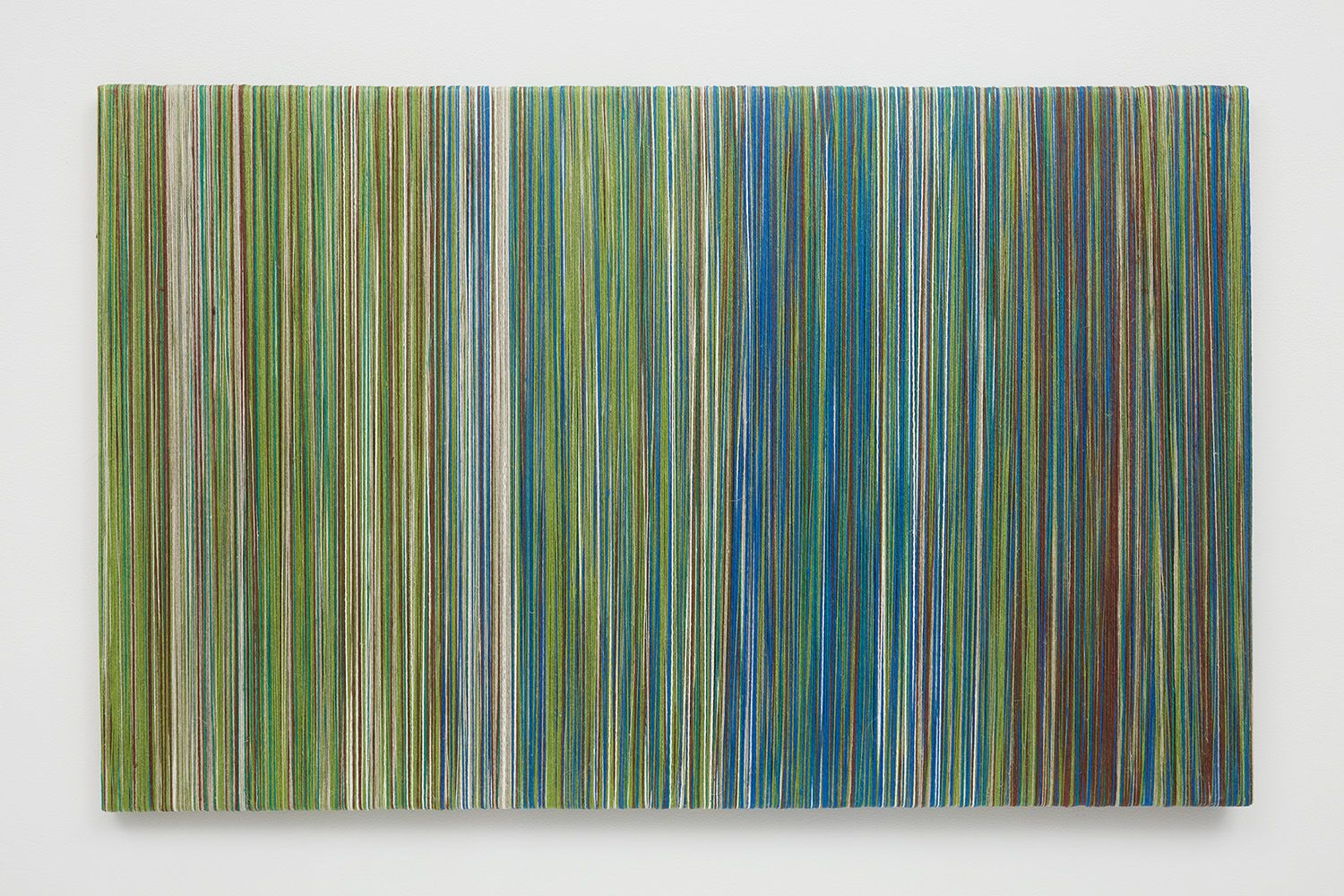 Wood board covered with thin lines of linen yarn by Sheila Hicks