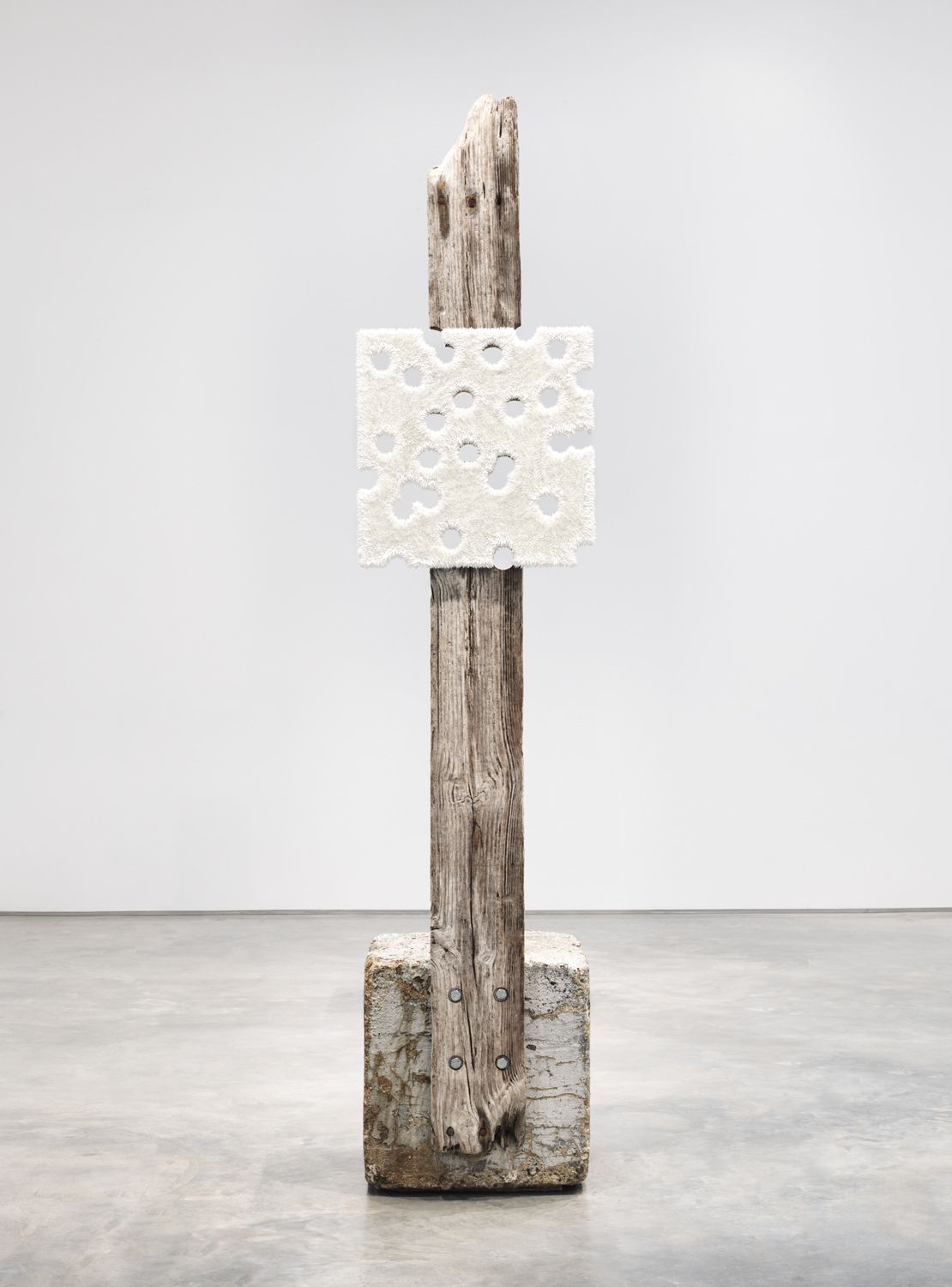 a glory hole white painting set on a piece of driftwood to make a sculptural artwork by donald moffett