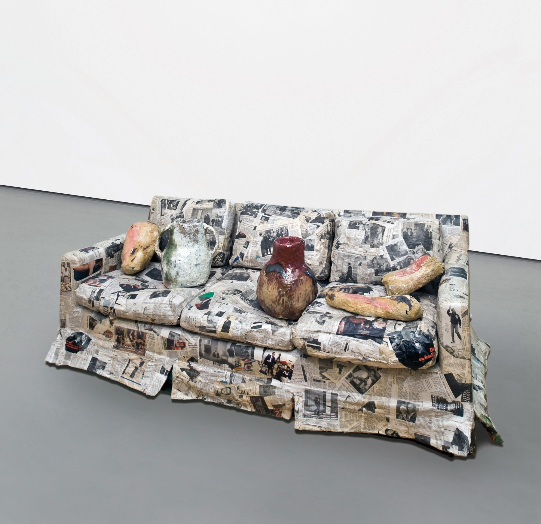 a sofa with ceramic artworks on it by jessica jackson hutchins for sale in an art gallery