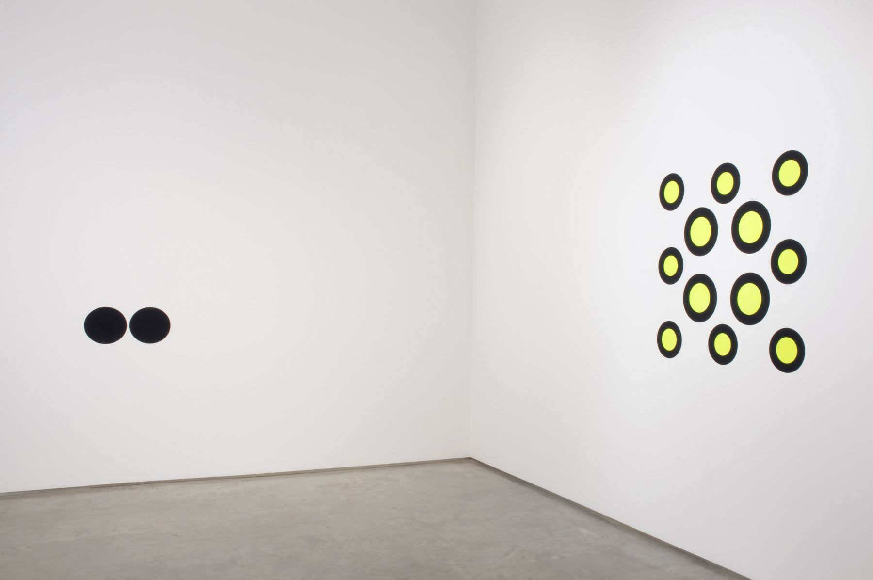 yellow and black dots painted on wall by neil campbell