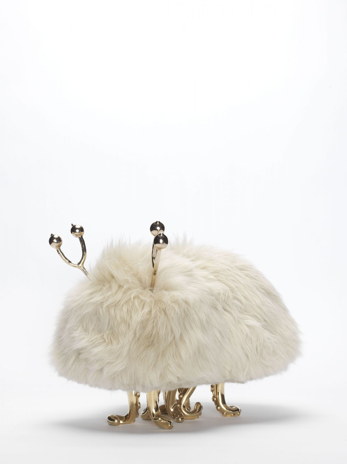 Sculpture made of stone sheepskin with brass squid legs and horns by the artists the haas brothers