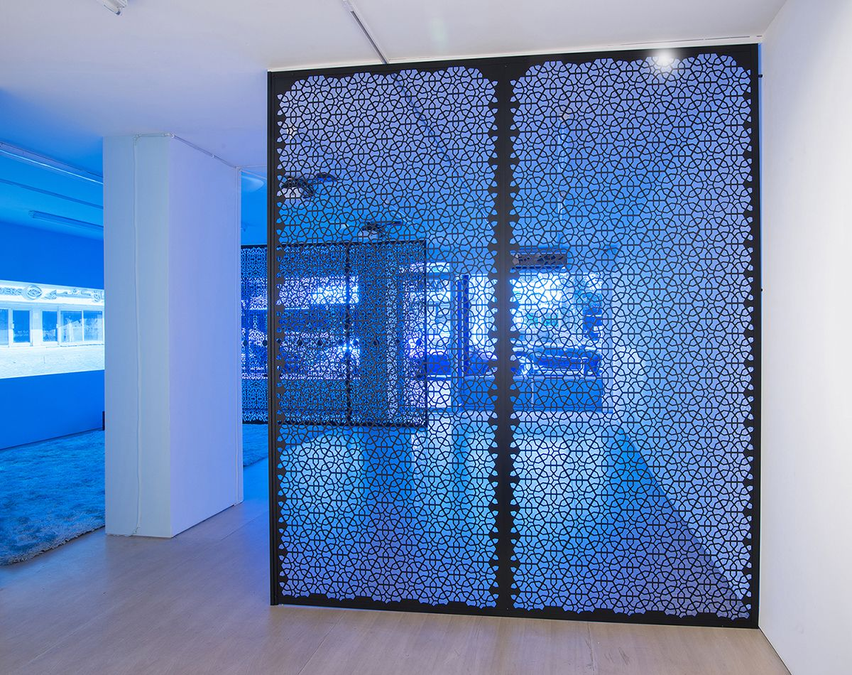 the blue lenses, a video installation, by sue de beer in the gallery in aspen