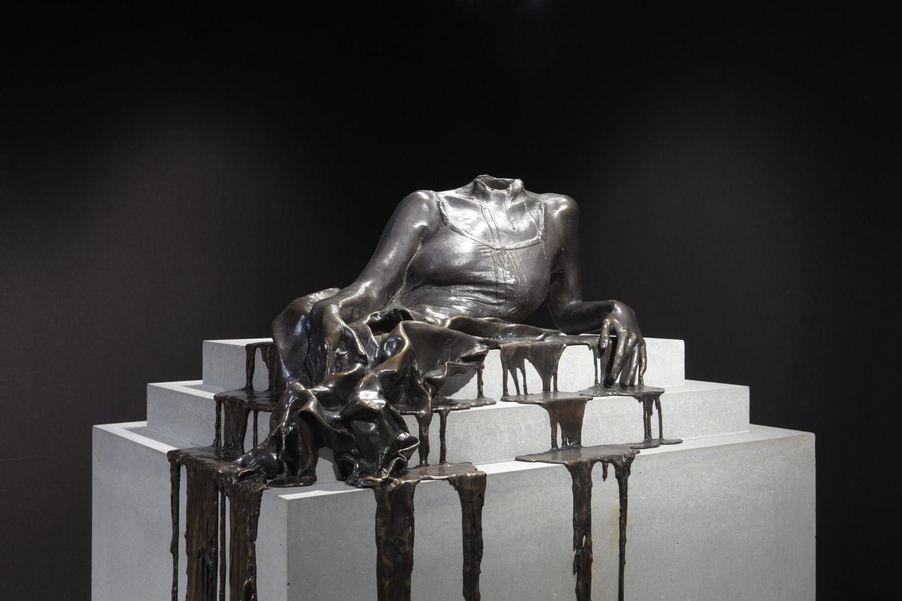 a bronze sculpture of a headless woman dripping off a pedestal by Diana Al-Hadid