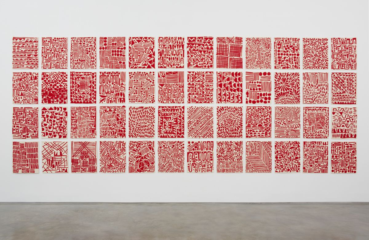 a grid series of red and white artworks by william j. o'brien for sale in a chelsea art gallery