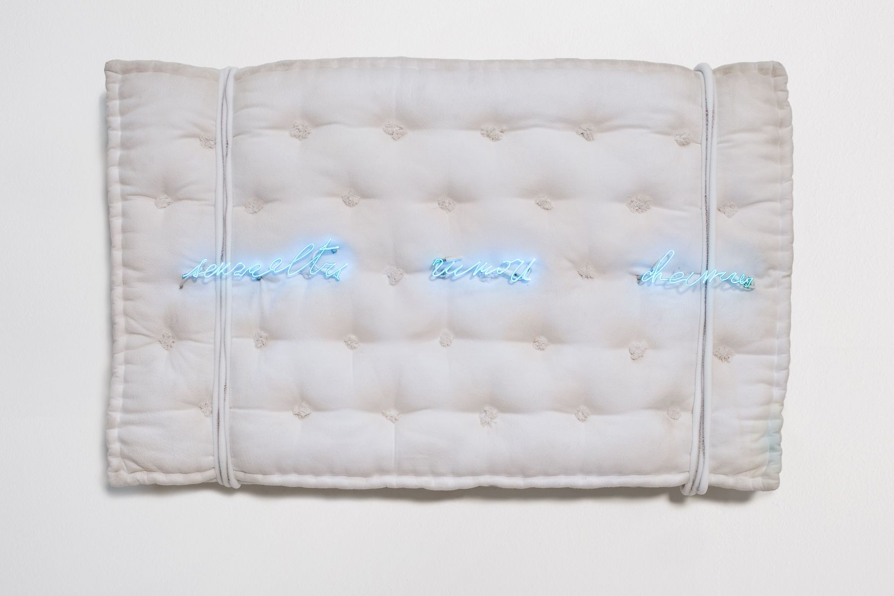 mattress with neon letters by pier paolo calzolari