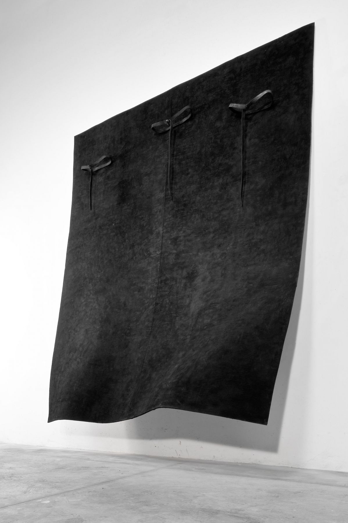 felt, leather, iron and metal sculpture by Italian contemporary artist Pier Paolo Calzolari