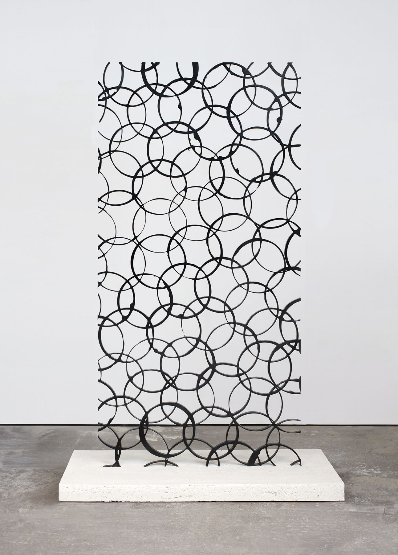 a steel sculpture by anthony pearson of concentric overlapping circles