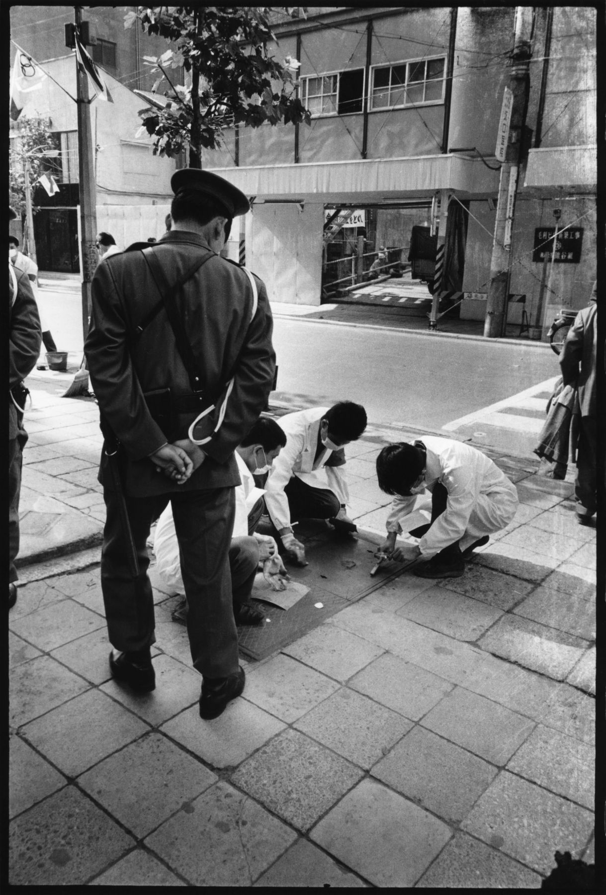 photo of people cleaning the street by minoru hirata