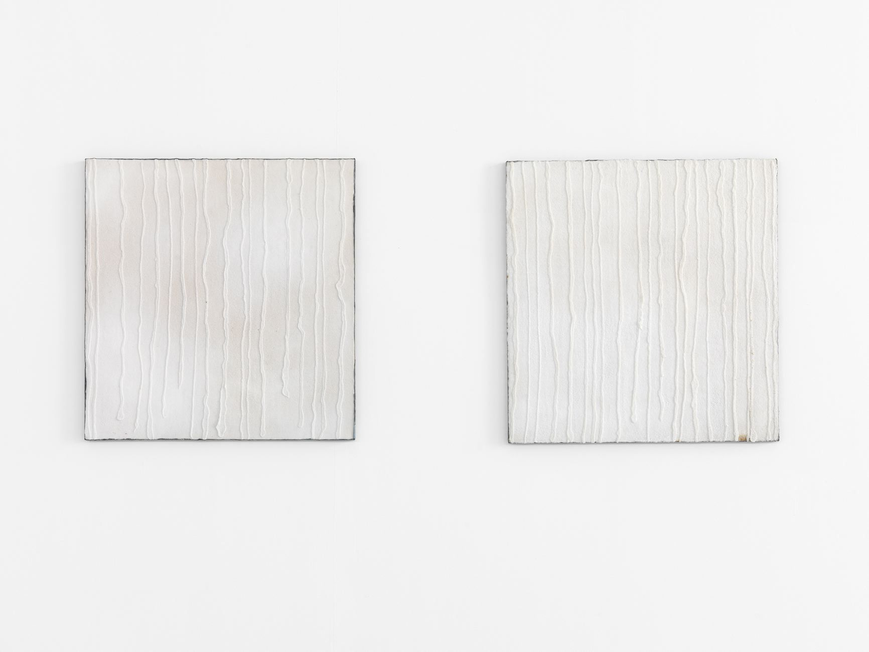 diptych with two white panels made of salt and lead by pier paolo calzolari