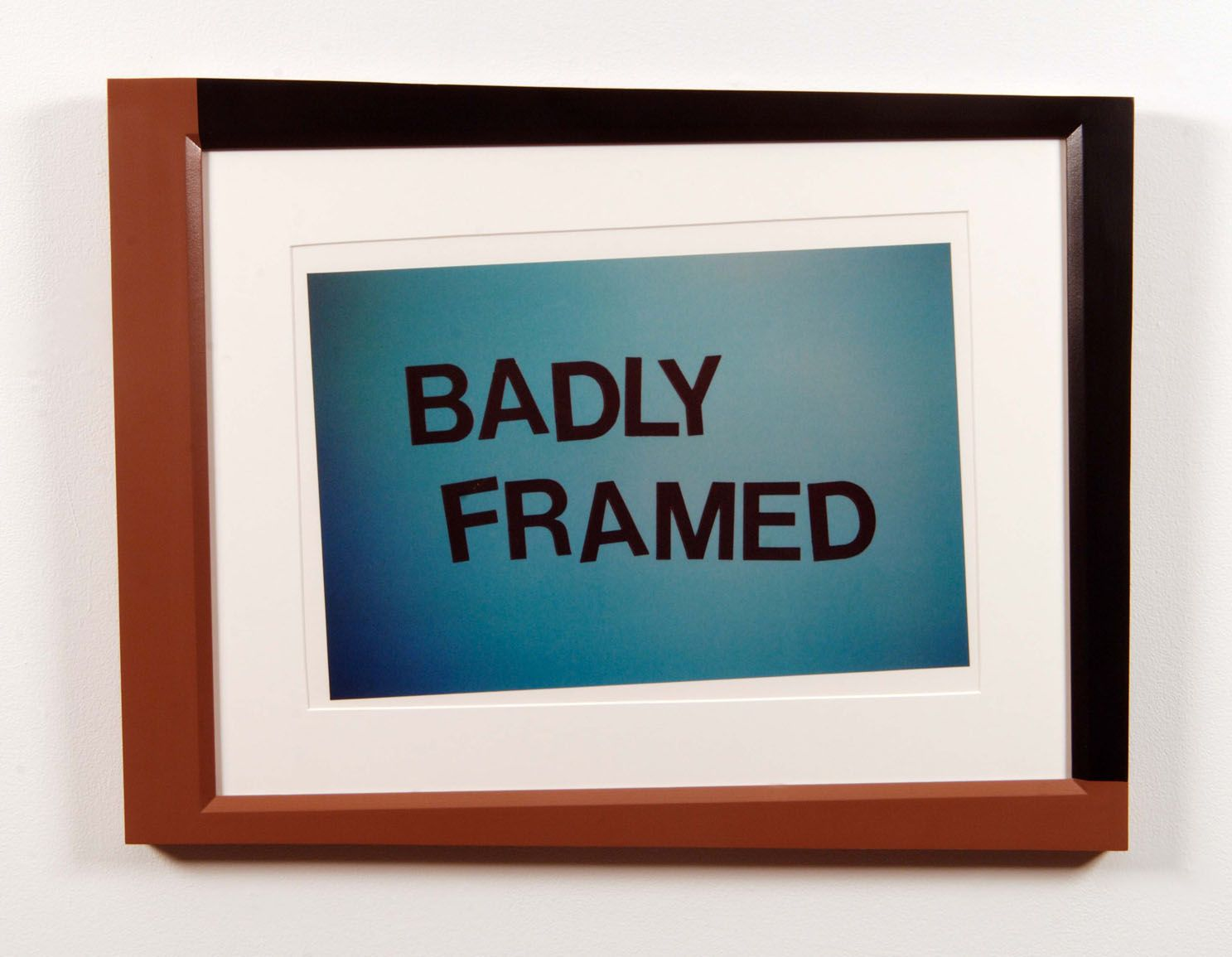 """crookedly framed image reading """"badly framed"""" by john waters"""
