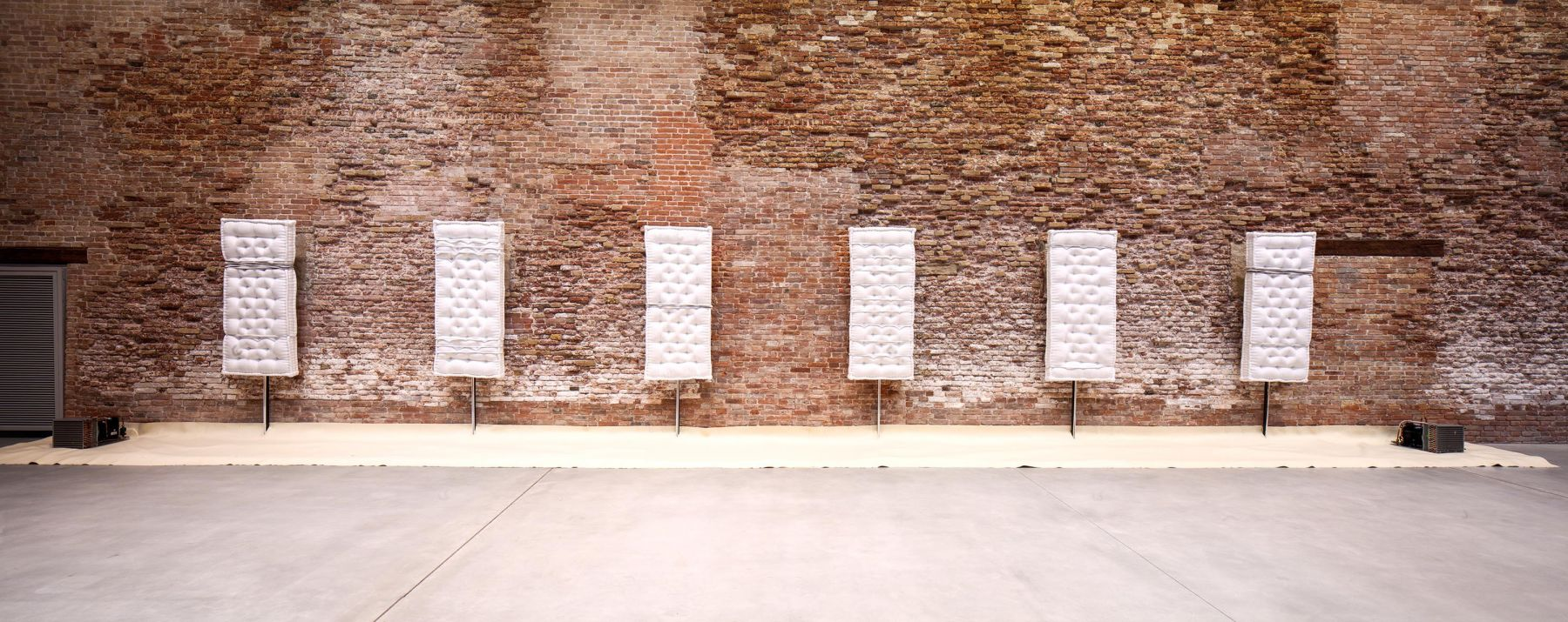 an installation of sculptures by Pier Paolo Calzolari in a contemporary art gallery